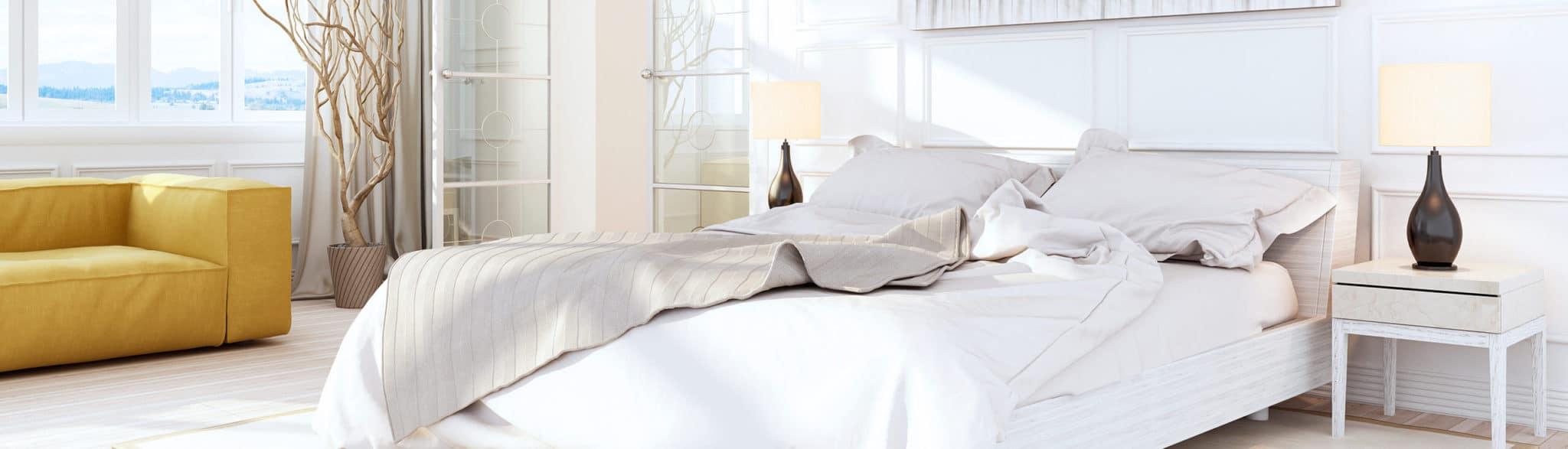 Dormitorio blanco con sofá - muebles de hogar en Madrid