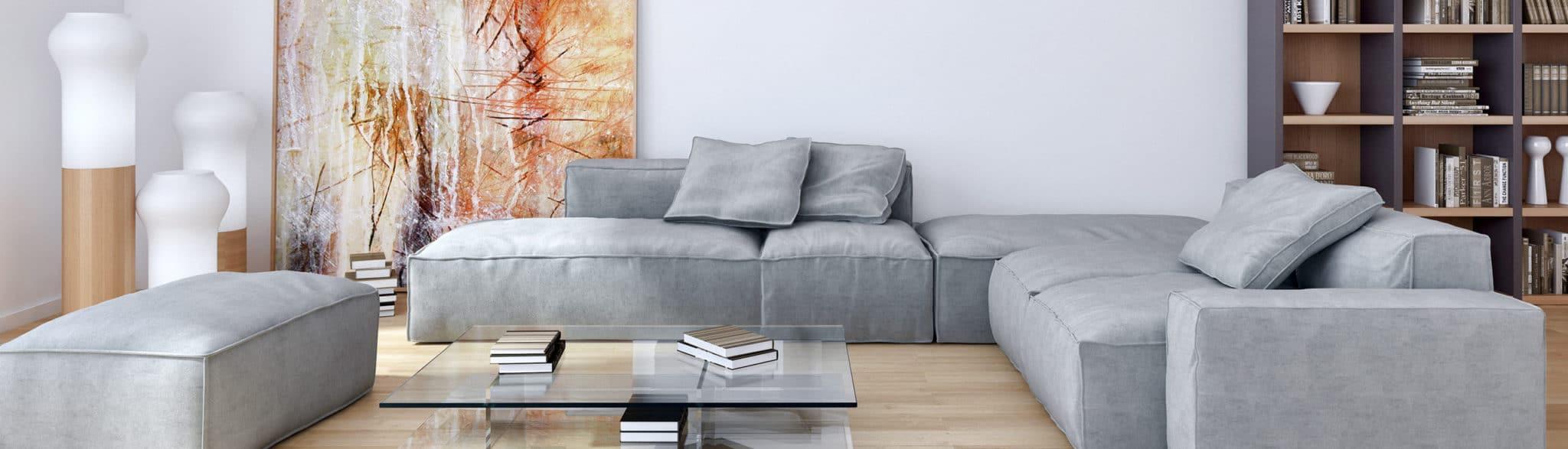 Salón con sofá gris y estantería - muebles de hogar en Madrid